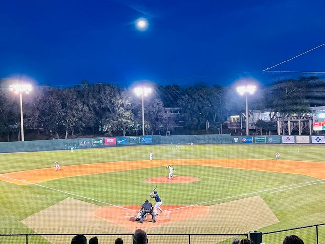 A full moon rises over John Sessions Stadium on Saturday during the baseball game between Jacksonville University and the University of North Florida.
