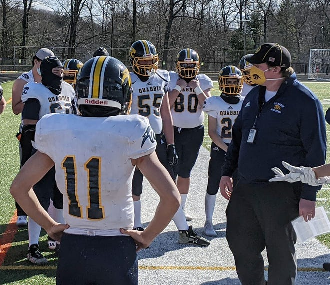 Dave Buchanan, shown at right talking to the Quabbin football team during halftime of a Fall II game against Narragansett at Gardner High's Watkins Field in March, resigned as head coach of the Panthers, Wednesday, after seven seasons at the helm of the program.