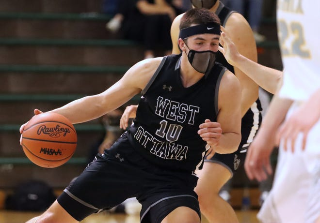 The Zeeland East boys defeated West Ottawa for the district crown on Saturday, March 27, 2021