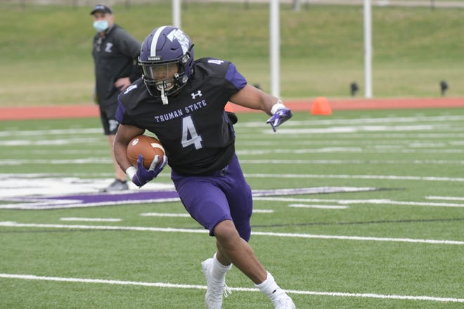 Truman senior running back Jaylen Jefferson carries the ball during Saturday's exhibition game against McKendree.