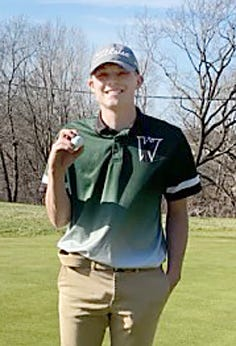 Westran High School senior Caleb Nagel holds the golf ball he used to record his first hole-in-one while playing in his school's home dual meet Thursday, March 26 at Heritage Hills Golf Course in Moberly. Nagel used a 9-iron on the 8th hole which was about 156 yards from the tee.
