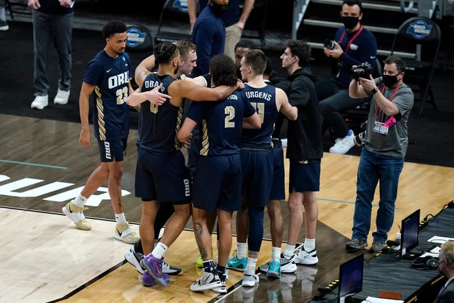 Oral Roberts players gather after losing a Sweet 16 game against Arkansas on Saturday night at Bankers Life Fieldhouse in Indianapolis. Arkansas won 72-70.
