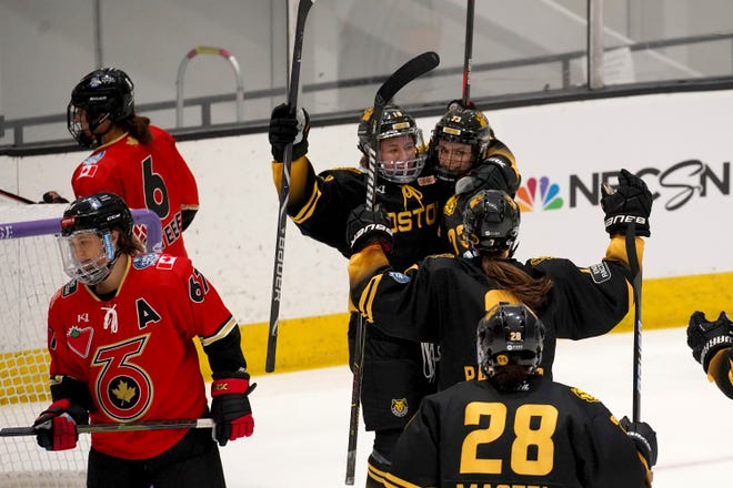 Boston Pride forward Tereza Vanisova (73) is congratulated by Taylor Wenczkowski (18) after scoring a goal against the Toronto Six during the first period of a WNHL hockey semifinal is the Isobel Cup, Friday, March 26, 2021, in Boston. (AP Photo/Mary Schwalm)