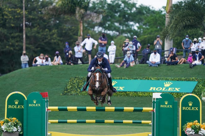 Germany's Daniel Deusser and his horse, Scuderia 1918 Tobago Z, turned in a time of 34.40 seconds in the jump-off of the Rolex Grand Prix Saturday at Stadium Derby Field at Equestrian Village.