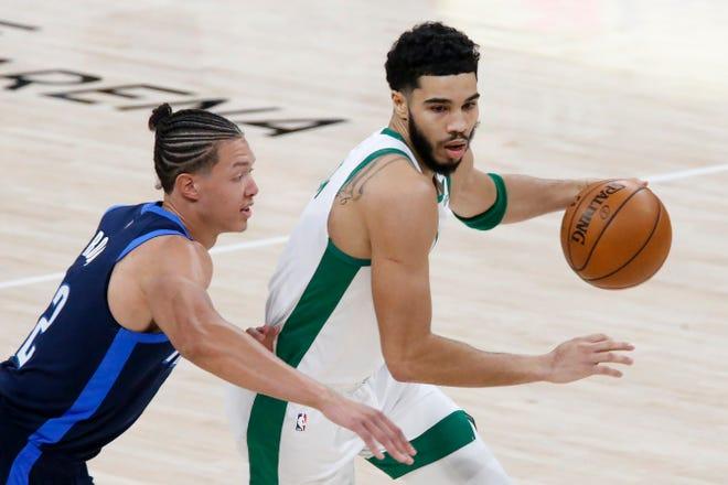 Boston Celtics forward Jayson Tatum (0) goes against Oklahoma City Thunder center Isaiah Roby (22) during the first half of an NBA basketball game Saturday, March 27, 2021, in Oklahoma City. (AP Photo/Garett Fisbeck)