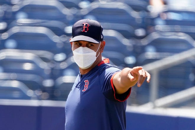 Boston Red Sox manager Alex Cora before a spring training baseball game against the Tampa Bay Rays on March 26, 2021, in Port Charlotte, Fla.