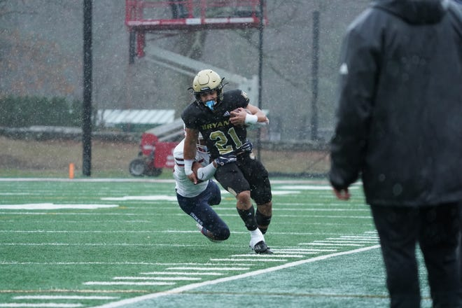 Bryant's Daniel Adeboboye, who rushed for a career-high 180 yards on 25 carries, runs down the sideline against Duquesne on a rain-drenched afternoon at Beirne Stadium on Sunday.