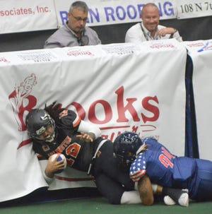 Salina Liberty defensive end Shaq Bradford (94) brings down Arlington quarterback Lauren Morales (12) during last Saturday's season opener. Bradford and the Liberty will face the Wichita Force at 6:30 p.m. Friday at Tony's Pizza Events Center.