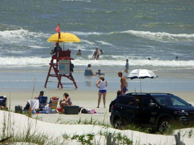 Lifeguards return to beach duty.