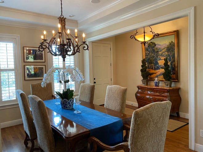 Light years ahead ― The author's dining room and foyer before and after getting a light fixture update. Changing light fixtures is a good time to upgrade lightbulbs, too.