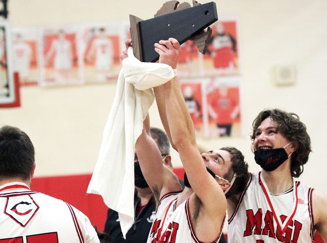 Colon's LaWayne Wickey and Josh West celebrate with the district championship trophy on Saturday night.