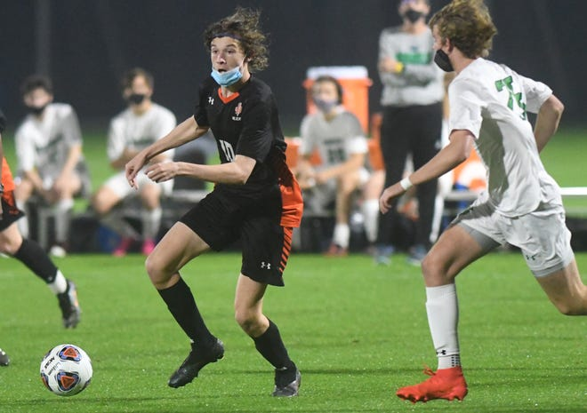 New Hanover forward Aidan Payne brings the ball up  against Weddington in the 3A State Championship at WakeMed Soccer Park in Cary, N.C., Saturday, March 27, 2021.  [MATT BORN/STARNEWS]