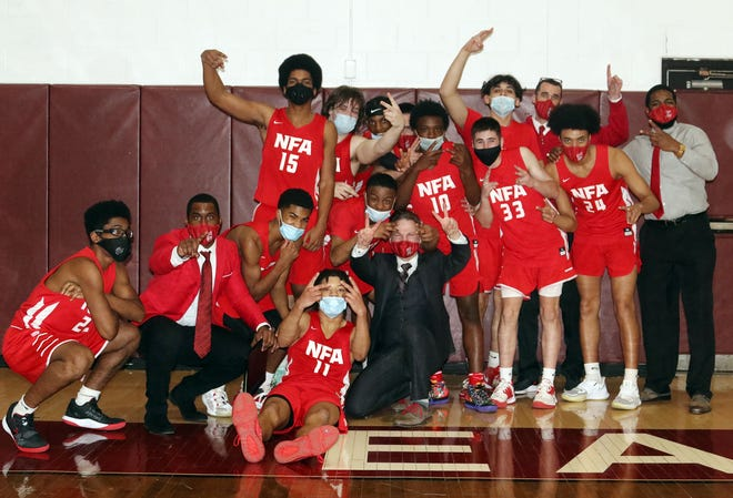 NFA celebrates their 48-43 ECC South Tournament win over East Lyme Saturday.