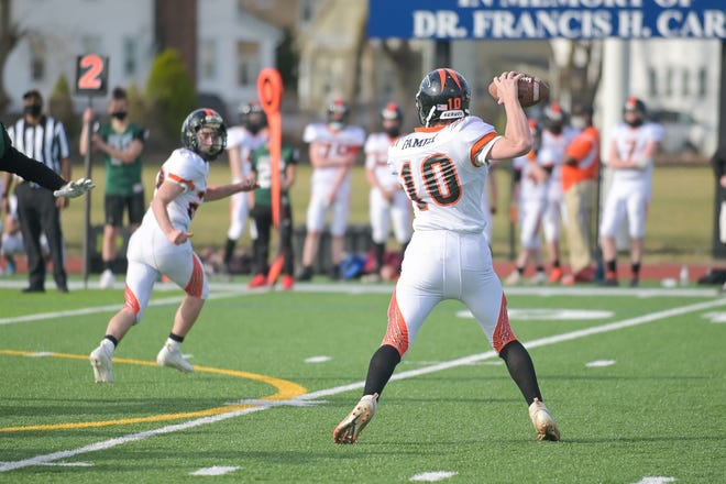 David Prouty's Zack Paine looks for an open receiver in the pocket against Burncoat.