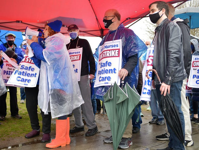 Wearing orange rain boots, nurse Marlena Pellegrino, leads off a rally Sunday with U.S. Sen. Edward Markey, Mayor Joseph Petty and U.S. Rep. James McGovern outside St. Vincent Hospital in Worcester, where striking nurses have maintained a picket line.
