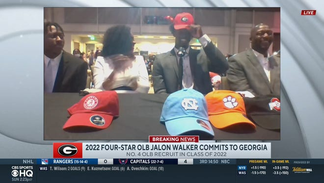 Four-star 2022 Salisbury outside linebacker Jalon Walker puts on a Georgia hat after verbally committing to the Bulldogs in a livestreamed ceremony Sunday.