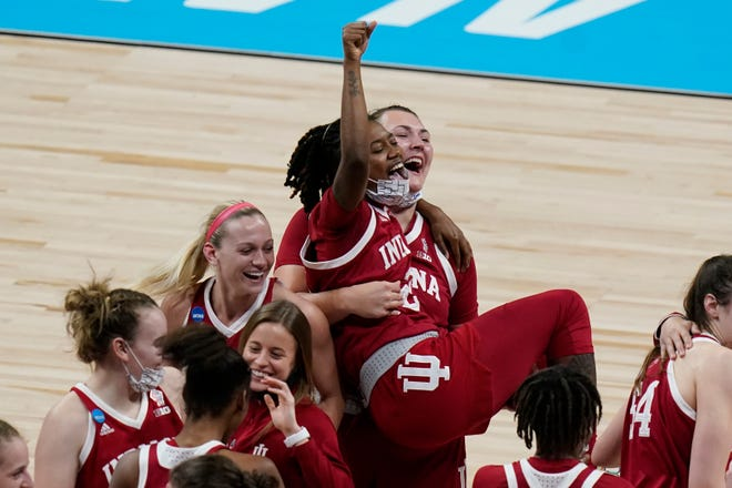 Indiana players celebrate their 73-70 win over the Mercado Region's top-seeded NC State on Saturday.