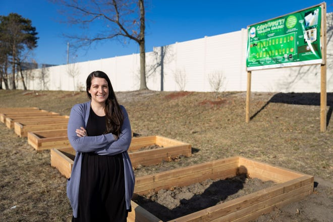 Andrea Cameron stands on site the Indian Lake Community Association Community Teaching Garden on West Boylston Drive in Worcester.