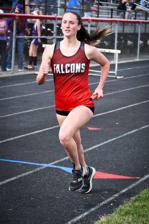 Fairfield Union's Madison Eyman runs a relay race Saturday afternoon at Liberty Union High School. -Jamie Potts/Lancaster Eagle Gazette