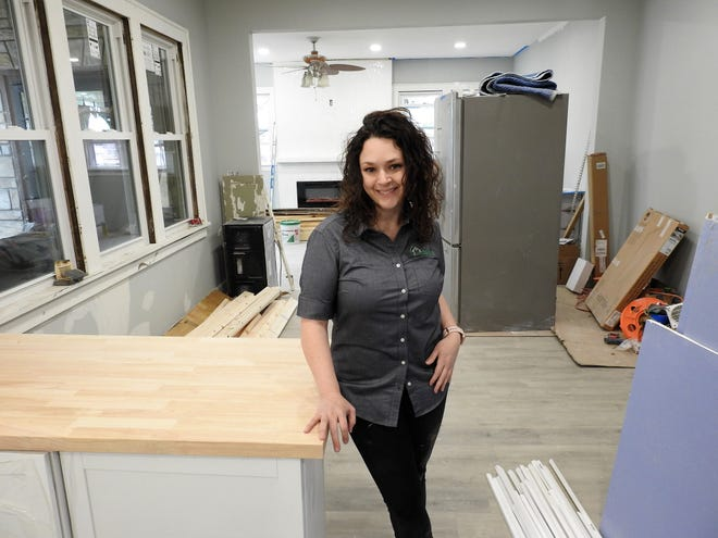 Lisa Chau of Motivated Home Buyer is finishing work at a unique, historic home at 546 Cambridge Road. She said the core work is done and now they are finishing work and putting things together.