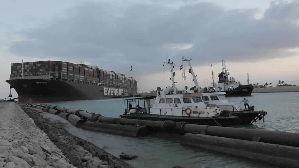 Two more tugboats on way to help free ship stuck in Suez Canal 2