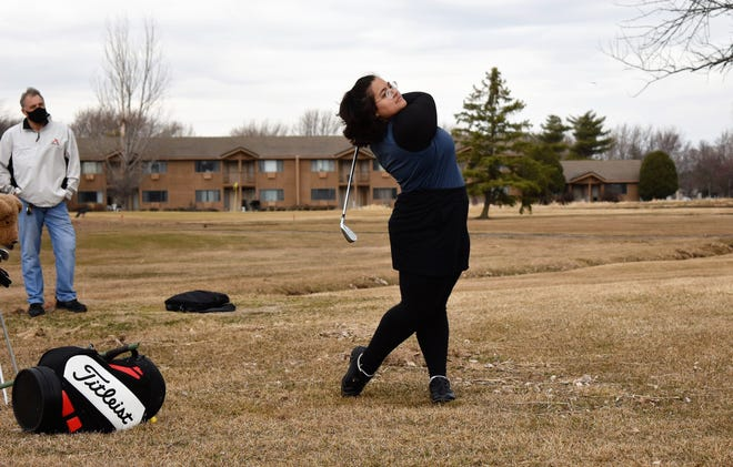 AJ Powell, a sophomore at Appleton North, hits balls at High Cliff Golf Course in Sherwood on March 23. She will compete in the Drive, Chip and Putt National Finals next month in Augusta, Ga.