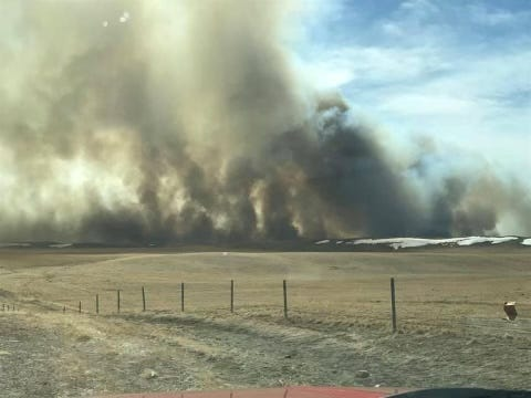 Two grass fires were burning on the Blackfeet Reservation Sunday, with one near the community of Blackfoot causing tribal police to ask residents to evacuate their homes.