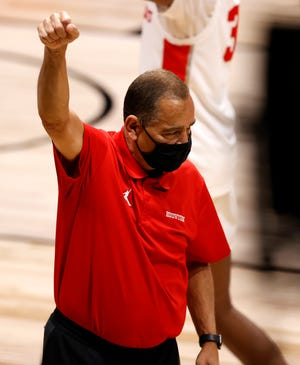 Houston head coach Kelvin Sampson pumps his fist in the air after defeating Syracuse during the Sweet 16 round of the NCAA Tournament on Sunday. The Cougars face Oregon State on Monday with the winner advancing to the Final Four.