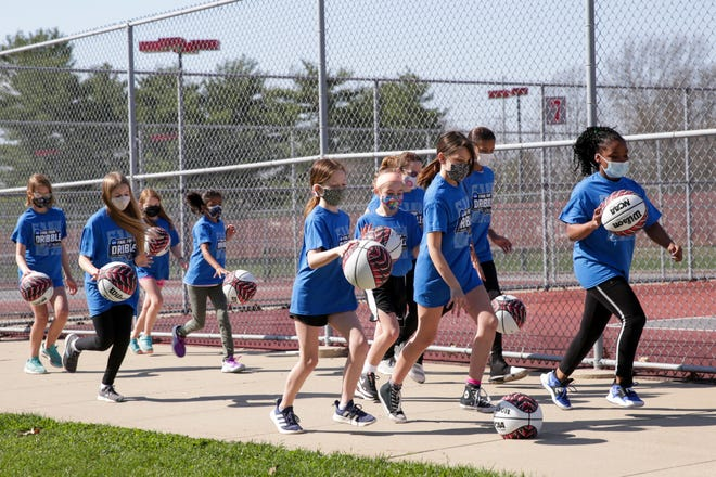 A group of West Lafayette Elementary School fifth graders dribble basketballs as they participate in the NCAA Final Four Dribble, Saturday, March 27, 2021 in West Lafayette.