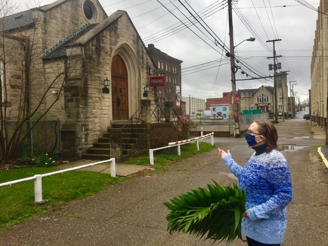 Newark First Presbyterian Church plans a drive-in Easter worship. A first such in-car worship was set for Palm Sunday, but canceled that same morning over weather concerns. Priscilla Hare, church leadership team member, was nevertheless on site to greet and distribute palms to those who didn't get word of the change of plans March 28.