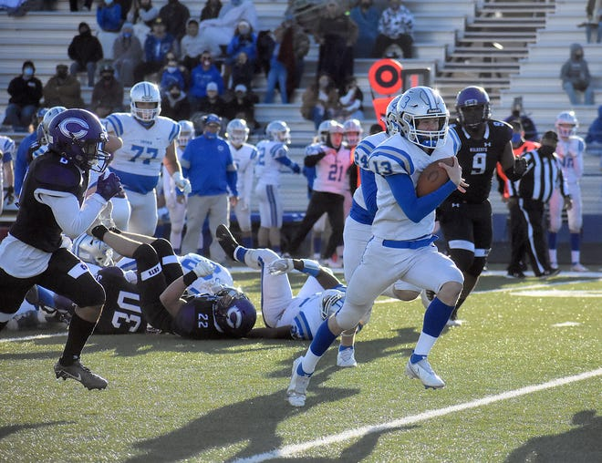 Carlsbad quarterback Dane Naylor finds daylight on a 34-yard touchdown run in the second quarter of Saturday's game at Leon Williams Stadium in Clovis. Naylor rushed for 104 yards in the 55-20 defeat.