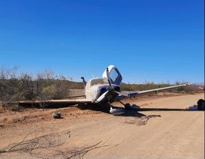A plane crash landed on Pump Station Road in Avra Valley, Ariz. March 28, 2021.