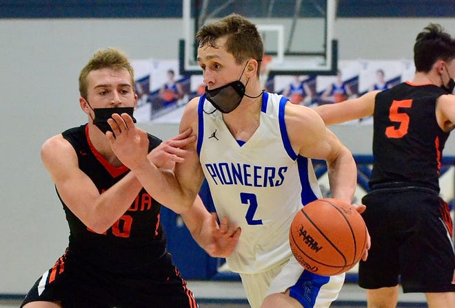 Croswell-Lexington's Hunter Soper drives to the hoop against Armada's Eric Keding during the Division 2 boys basketball district championship on Saturday, March 27, 2021, at Yale.