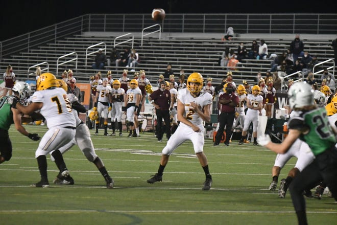 Simi Valley quarterback Travis Throckmorton fires a touchdown pass against Thousand Oaks during the teams' game on Saturday, March 27, 2021. Simi Valley won, 35-7.