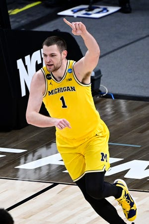 Michigan Wolverines center Hunter Dickinson reacts after dunking during the Sweet 16 matchup against Florida State.