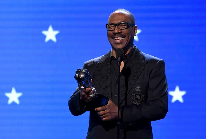 In this Jan. 12, 2020, file photo, Eddie Murphy accepts the lifetime achievement award at the 25th annual Critics' Choice Awards in Santa Monica, Calif.  Murphy will be inducted into the NAACP Image Awards Hall of Fame this month.