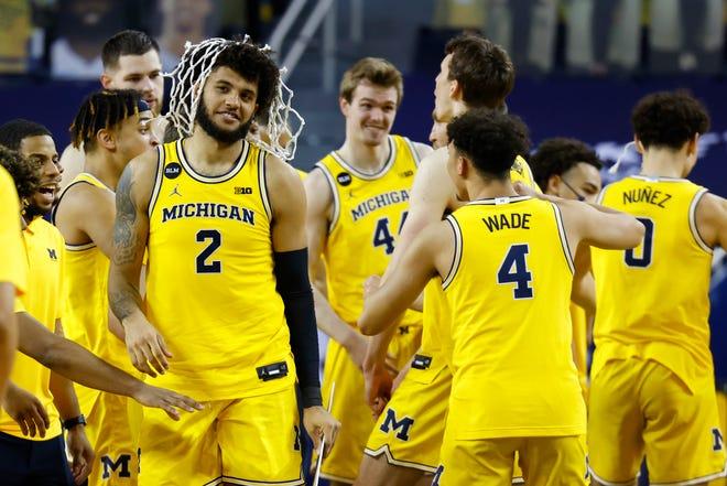 Michigan Wolverines forward Isaiah Livers (2) celebrates winning the Big Ten regular-season championship.