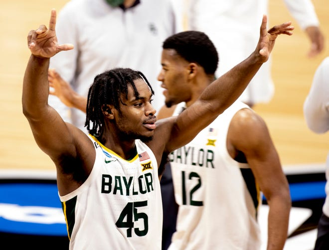 Baylor Bears guard Davion Mitchell (45) celebrates as he leaves the court after defeating Villanova in the Sweet 16 of the men's NCAA Tournament.