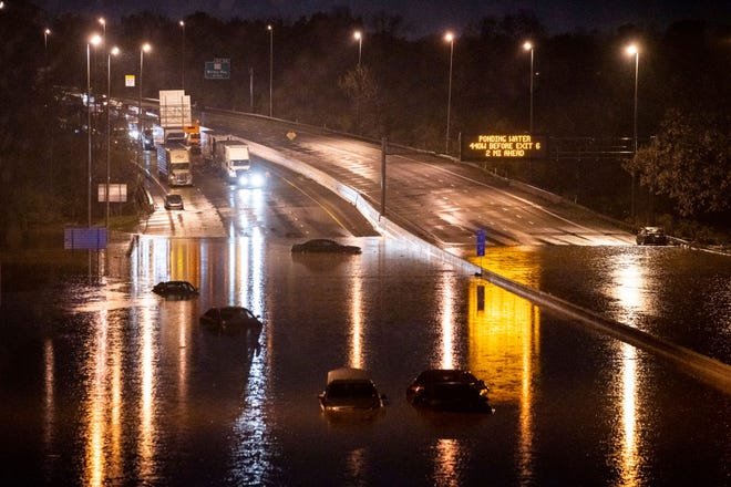 Cars are seen submerged on I-24 near Antioch Pike in Nashville, Tenn., Sunday, March 28, 2021. Heavy rain across Tennessee flooded homes and roads early Sunday, prompting officials to rescue numerous people from houses, apartments and vehicles as a line of severe storms crossed the state.