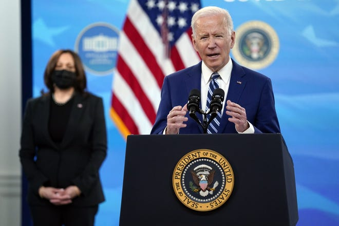 President Joe Biden speaks about COVID-19 vaccinations Monday as Vice President Kamala Harris listens. The Biden administration has extended a moratorium on evictions during the COVID-19 pandemic.