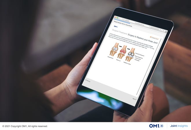 The artificial intelligence tool developed by OM1 and Dell Medical School gives information on a tablet about knee replacement.