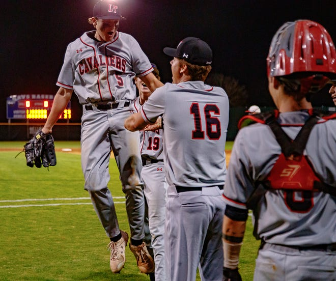 Lake Travis pitcher Ethan Calder, left, celebrates with Giacomo Hester, center, and others after a 4-3 win over the Hays Rebels last week that helped the Cavs remain undefeated in District 26-6A.