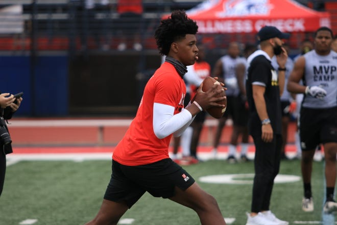 Walter Taylor loads up to throw a pass at Sunday's MVP Camp at Milton High School.