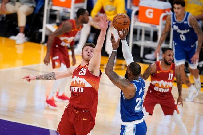 Former Denver Nuggets center Isaiah Hartenstein, facing, is looking forward to getting more playing time and learning with the rest of his young Cavaliers teammates. [Marcio Jose Sanchez/Associated Press]