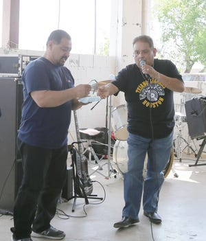 Tejano Legends of Houston's Mike Ramirez Jr. (right) presents Ted Lopez (left) with his award.