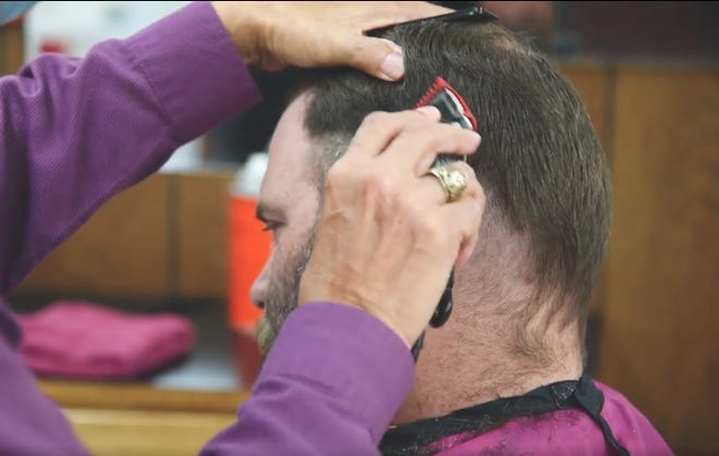 Alice HS teacher, James Shipp, get a 'mullet' haircut as part of a deal with freshman student on attendance.