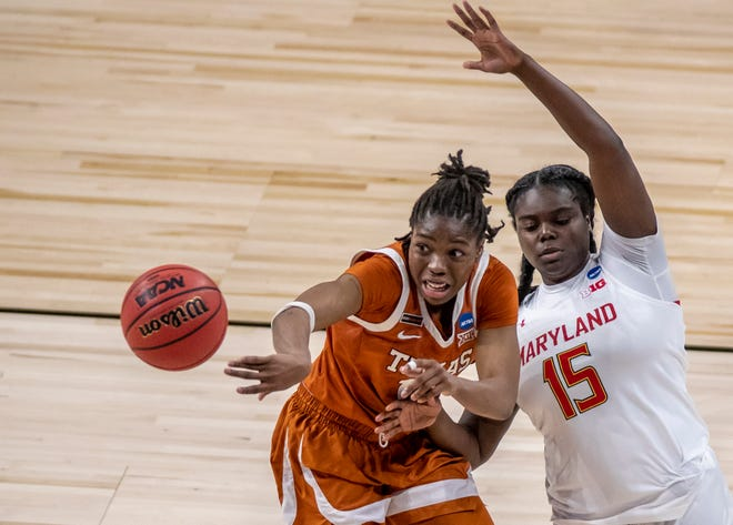 Texas guard Joanne Allen-Taylor (11) passes the ball as Maryland guard Ashley Owusu (15) tries to defend on the play during the second half of an NCAA college basketball game  in the Sweet 16 round of the Women's NCAA tournament Sunday, March 28, 2021, at the Alamodome in San Antonio. Texas moves on to the elite eight after winning against Maryland  64-61.