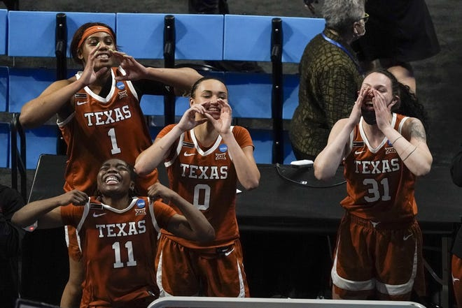 Texas' Lauren Ebo, Joanne Allen-Taylor, Celeste Taylor and Audrey Warren celebrate after Sunday night's 64-61 win over Maryland in the Sweet 16 of the NCAA Tournament. The Longhorns meet top-seeded South Carolina in Tuesday's Elite Eight.