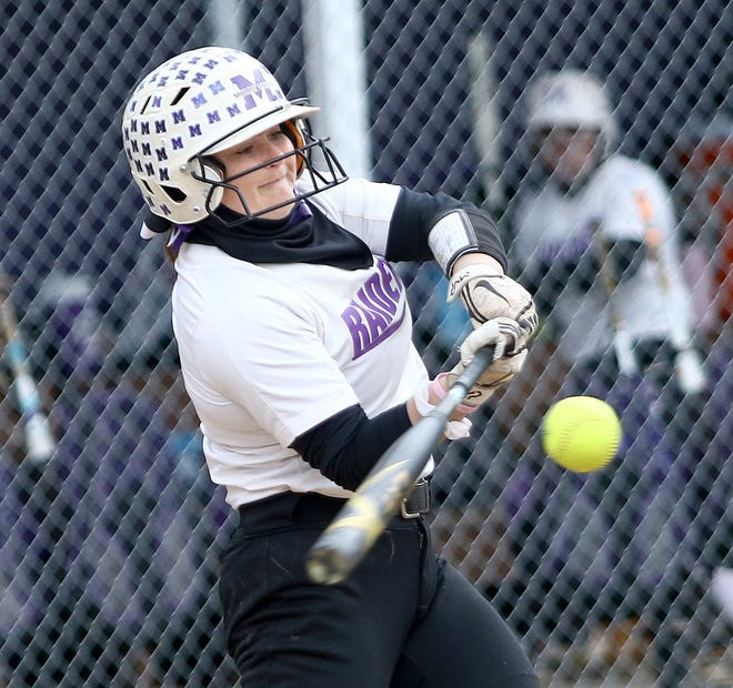 Mount Union's Maddie Pidgeon swings at an Otterbein pitch during the first game of a doubleheader at Mount Union Sunday afternoon, March 28, 2021.