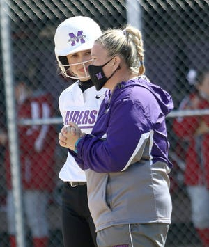Mount Union's Grace Heath, left, talks to coach Megan Simons, right, during a game this season. Heath, a West Branch High graduate, was named the Ohio Athletic Conference player of the year, and Simons was named coach of the year.